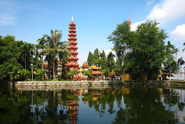 Tran Quoc Pagoda surrounded by lush green and silver lake